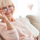 Elderly Woman sitting by her laptop