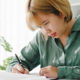 Woman sitting by a desk